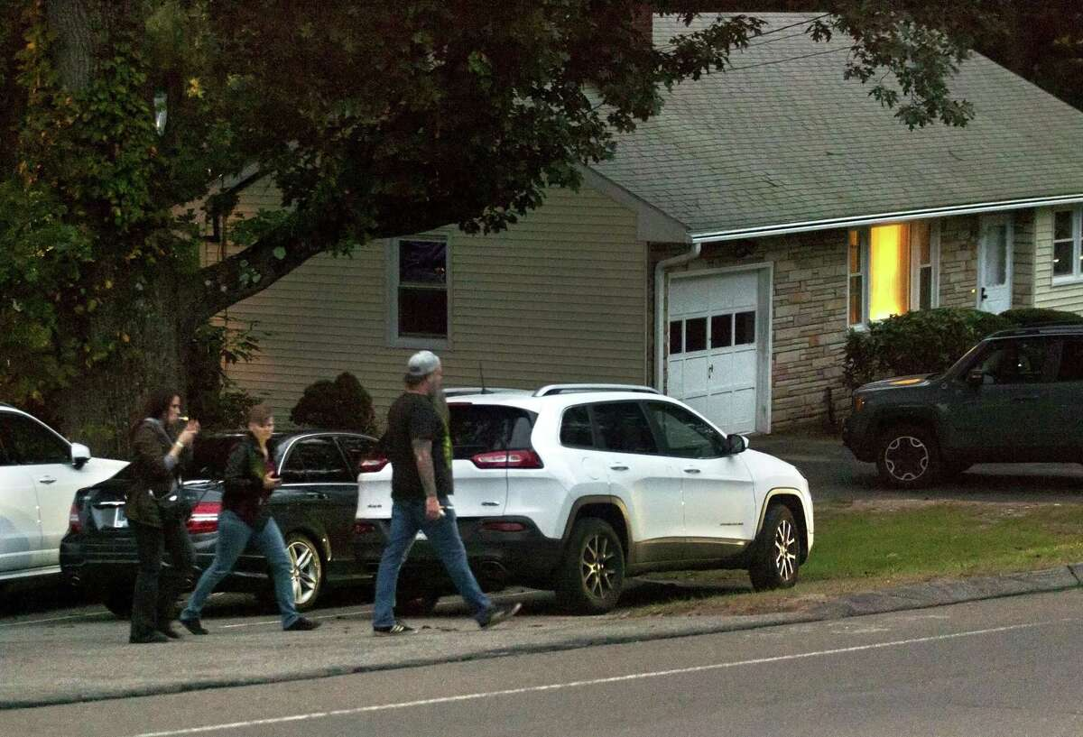Customers who parked in an upper lot, walk along Marshall Lane to get to THC The Hops Company on Sodom Lane in Derby, Conn. on Saturday Oct. 6, 2018. THC The Hops Company is seeking a zone change to expand. Neighbors are opposed to it citing cars parking throughout their neighborhood, garbage being strewn on their laws and loud music being played.