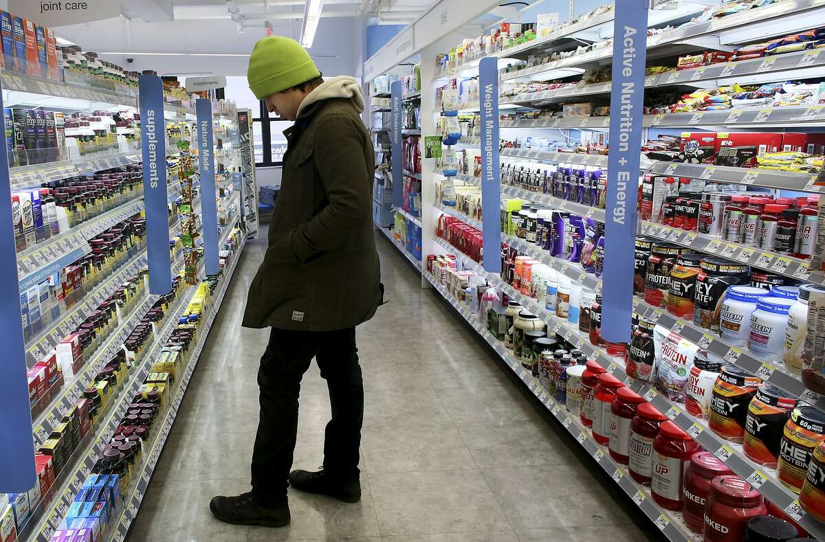 A shopper peruses pills at a Walgreens, one of three chains accused by New York State officials of selling fraudulent supplements, in New York, Jan. 28, 2015. GNC, the country's largest specialty retailer of dietary supplements, has agreed to test the purity of its herbal products after accusations of selling supplements that were fraudulent or contaminated with unlisted ingredients that could pose health risks to consumers. (Yana Paskova/The New York Times)