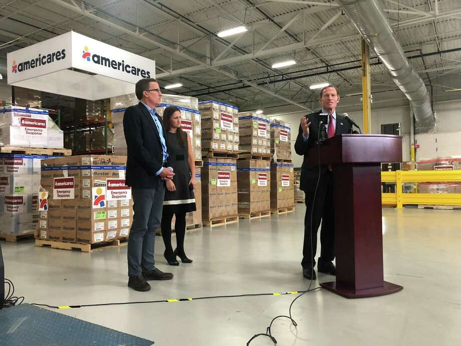 United States Senator Richard Blumenthal, D-Conn., speaks at a press conference inside the Stamford headquarters and distribution center of Americares, one of the largest nonprofit providers of donated medicine and medical supplies, alongside Americares President and CEO Michael J. Nyenhuis and Americares Vice President of Emergency Programs Kate Dischino. Photo: Ignacio Laguarda / Hearst Connecticut Media / Stamford Advocate