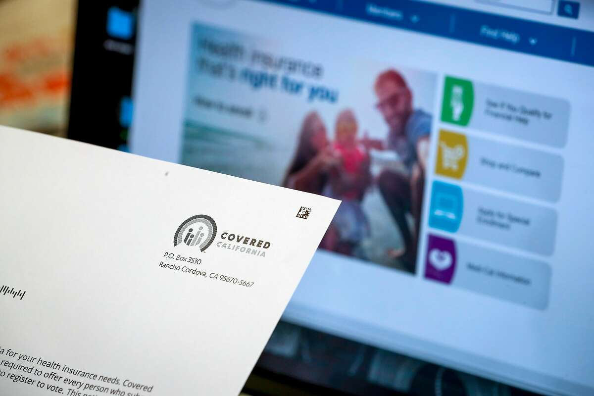 Tiffany Lin, a part-time teacher, opens a acceptance letter from Covered California at her parents home on Thursday, May 17, 2018, in Cupertino, California. A new UC study projects increasing numbers of Californians will lack health insurance in the years to come, thanks to the end of the federal individual mandate penalty.