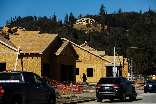 Construction workers build houses on Pacific Heights Drive after the Tubbs fire destroyed the neighborhood last year in Santa Rosa, California, on Friday, Sept. 28, 2018.