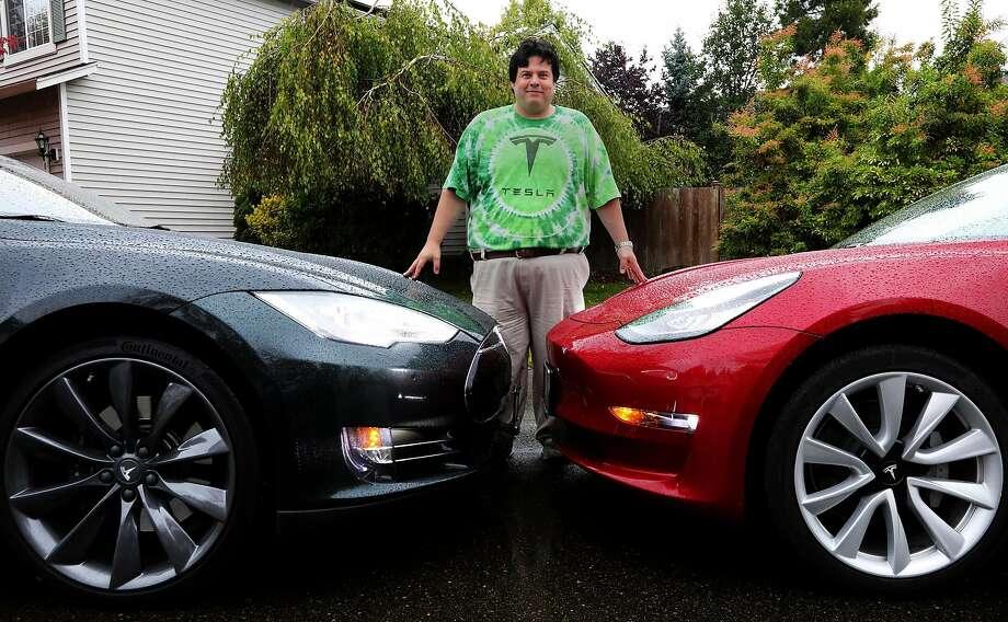 Matt Moreno of Washington state loves Tesla's electric vehicles. His family has two of them. Photo: Alan Berner / Seattle Times