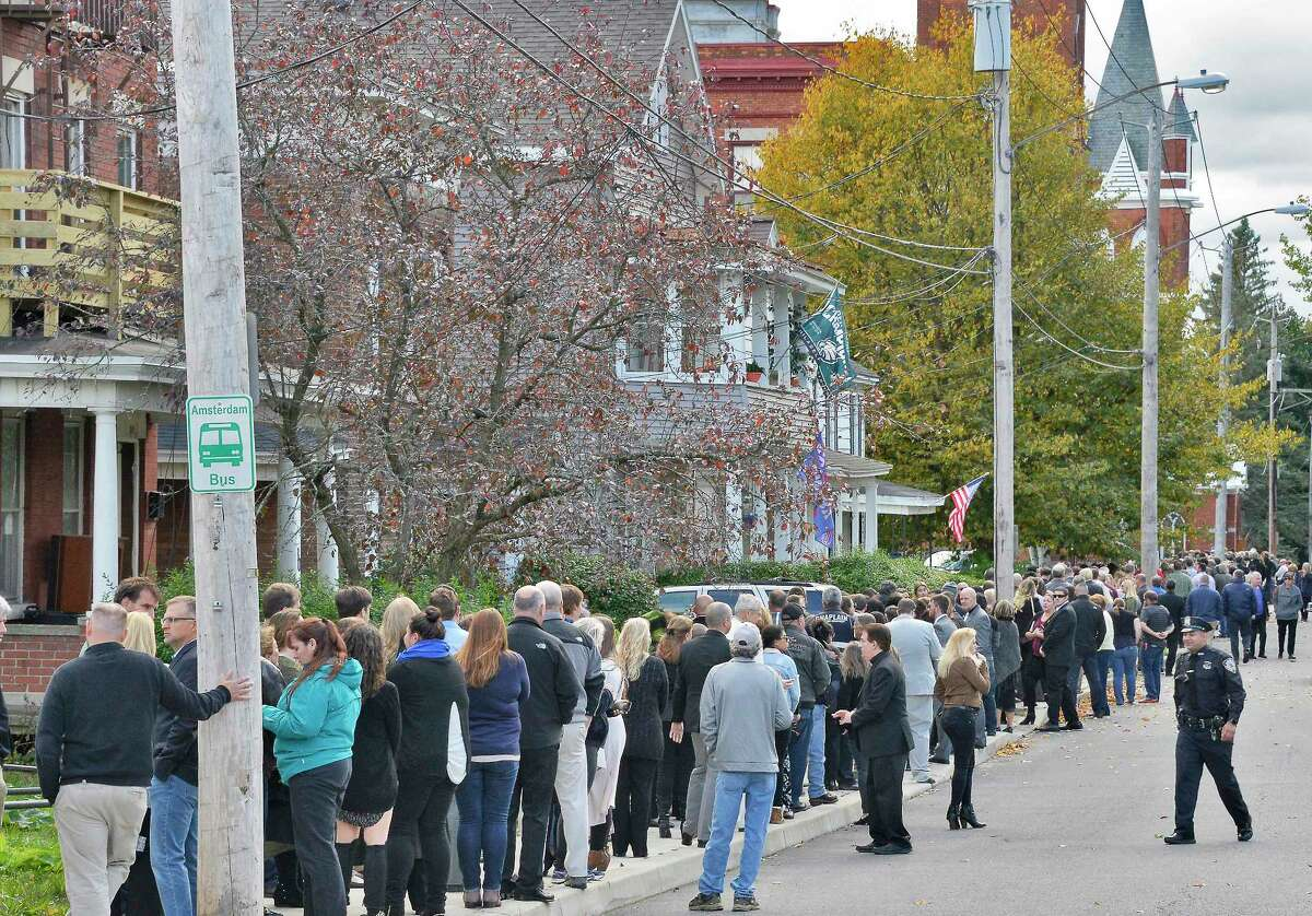 """Mourners line Cornell Street to attend calling hours for Schoharie limo crash victims; Abigail (King) Jackson, Adam """"Action"""" Jackson, Mary (King) Dyson, Robert J. Dyson, Allison A. King, Amy (King) Steenburg, Axel J. Steenburg and Richard Steenburg Jr., on Friday Oct. 12, 2018, at St. Stanislaus Roman Catholic Church in Amsterdam, N.Y. Funerla service will take place at the church on Saturday. (John Carl D'Annibale/Times Union)"""