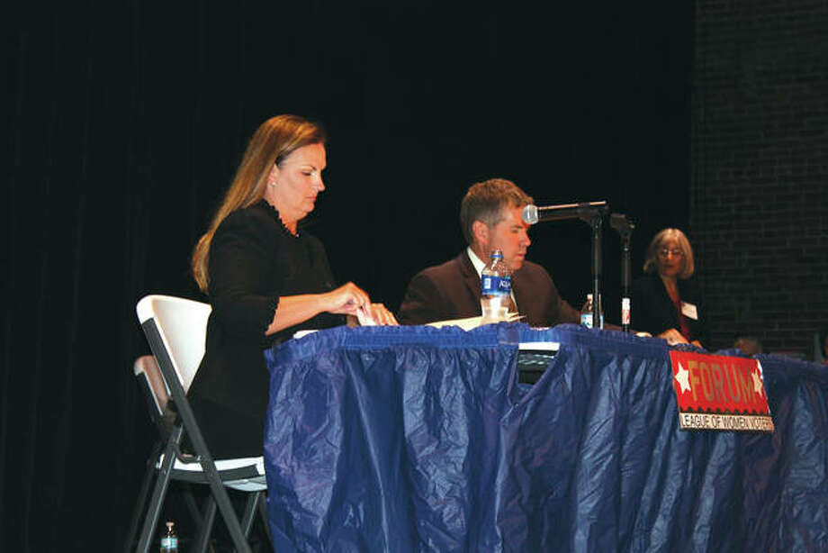 Illinois 56th District Senate candidates Rachelle Aud Crowe, left, and Hal Patton prepare to speak at Wednesday's Edwardsville Area League of Women Voters forum at the Wildey Theatre. Photo: Bill Tucker | For The Telegraph