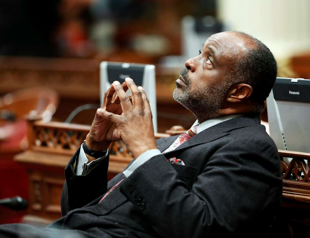 State Sen. Roderick Wright, D-Inglewood, takes a moment to look toward the ceiling on his first day in the Senate after last week's conviction for perjury, at the Capitol in Sacramento, Calif., Monday, Feb. 3, 2014. A Los Angeles County Superior Court jury found Wright guilty on eight counts of perjury and voter fraud. He faces up to eight years and four months in prison when he is sentenced on March 12. (AP Photo/Rich Pedroncelli)
