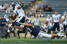 Yale's Daniel Debner trips up Maine's Micah Wright during a game earlier this season.