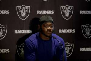 Oakland Raiders wide receiver Amari Cooper speaks during a press conference at the Hilton London Wembley hotel in London, Friday, Oct. 12, 2018. The Oakland Raiders arrived in Britain Friday for an NFL regular season game against the Seattle Seahawks in London on Sunday. (AP Photo/Matt Dunham)