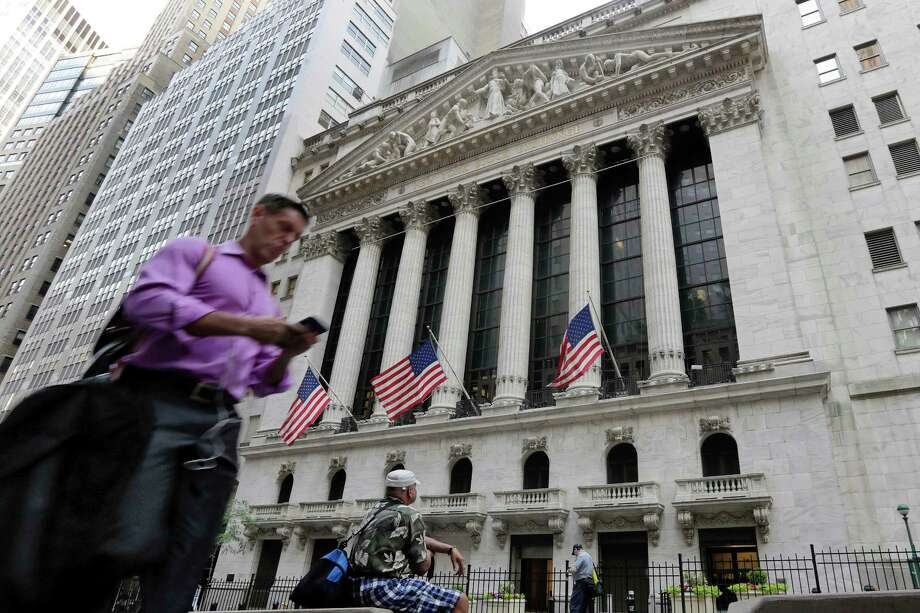 FILE - In this June 24, 2016, file photo, a man walks by the New York Stock Exchange. The U.S. stock market opens at 9:30 a.m. EDT on Friday, Oct. 12, 2018. (AP Photo/Richard Drew, File) Photo: Richard Drew / Copyright 2016 The Associated Press. All rights reserved. This m