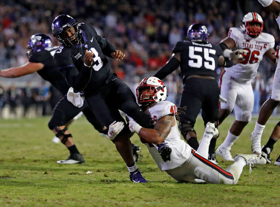 Texas Tech's Dakota Allen (40) tackles TCU's Shawn Robinson (3) during the second half of an NCAA college football game Thursday, Oct. 11, 2018, in Fort Worth, Texas. (Brad Tollefson/Lubbock Avalanche-Journal via AP) Photo: Brad Tollefson/Lubbock Avalanche-Journal Via AP