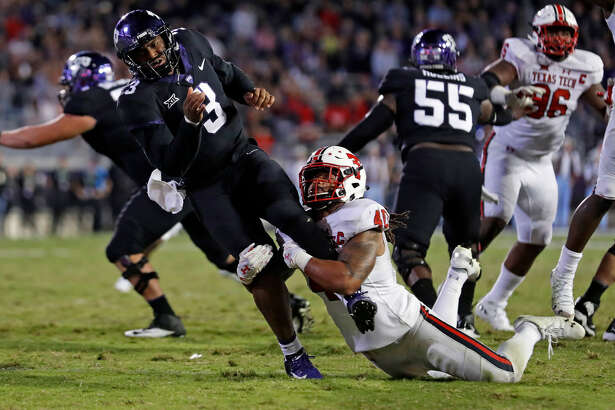 Texas Tech's Dakota Allen (40) tackles TCU's Shawn Robinson (3) during the second half of an NCAA college football game Thursday, Oct. 11, 2018, in Fort Worth, Texas. (Brad Tollefson/Lubbock Avalanche-Journal via AP)