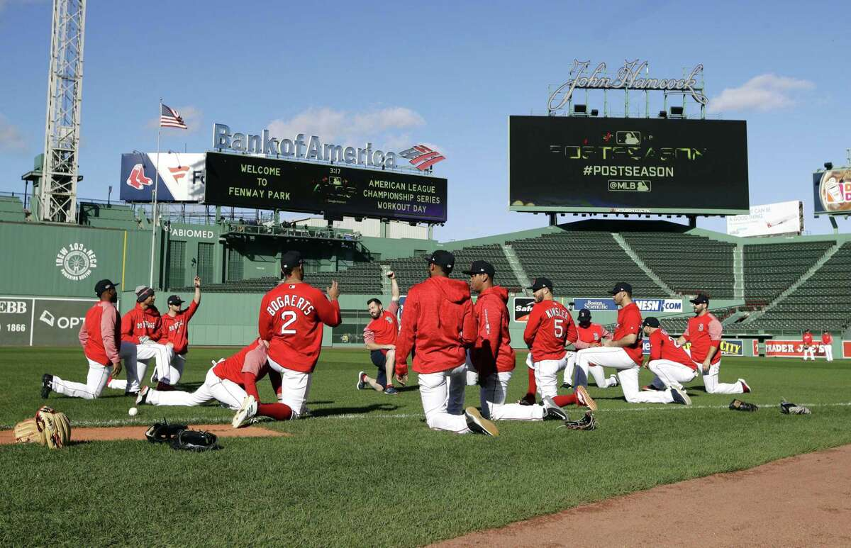 Boston Red Sox players work out at Fenway Park, Friday, Oct. 12, 2018, in Boston. The Red Sox are to face the Houston Astros in Game 1 of the baseball American League Championship Series Saturday in Boston. (AP Photo/Elise Amendola)