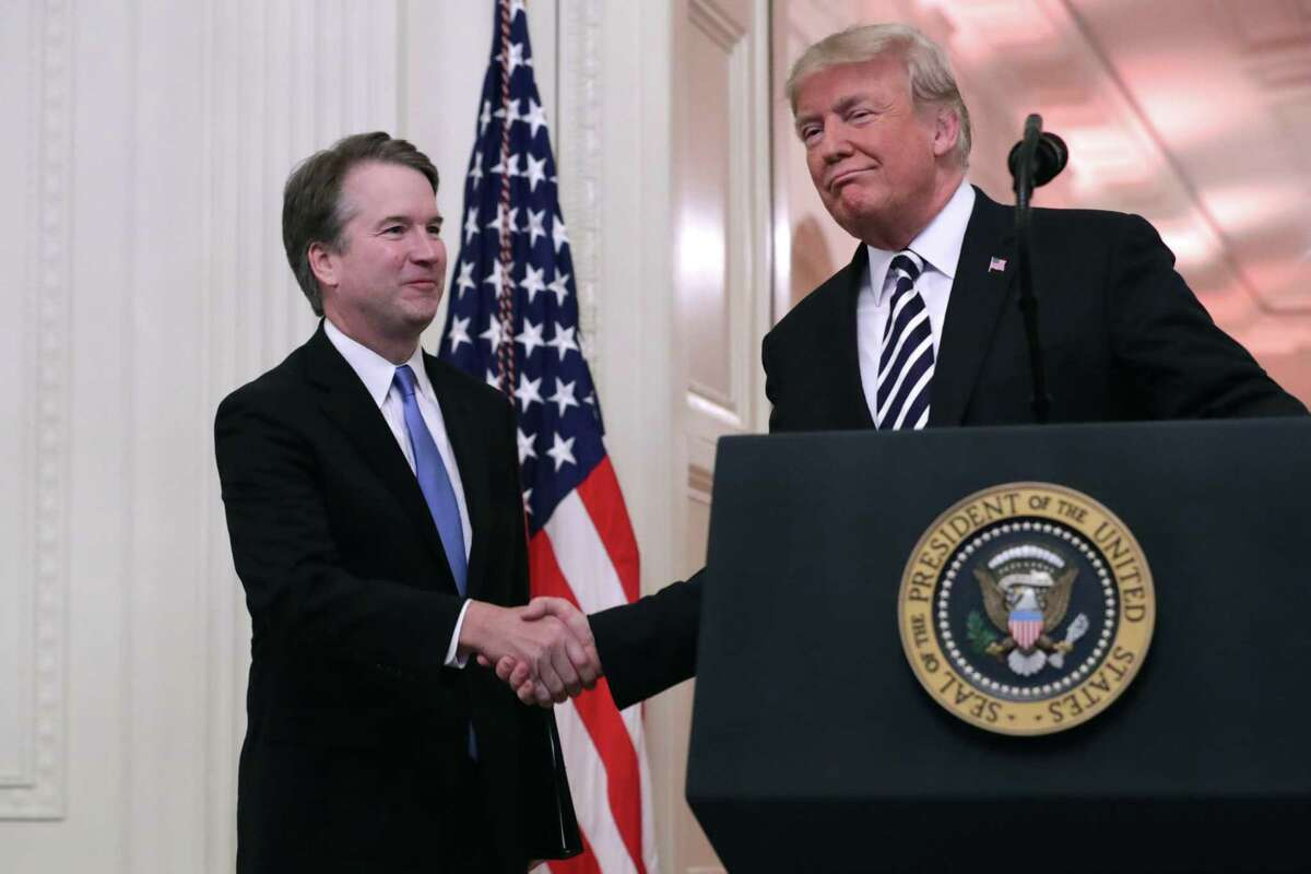 WASHINGTON, DC - OCTOBER 08: U.S. Supreme Court Justice Brett Kavanaugh (L) shakes hands with President Donald Trump during Kavanaugh's ceremonial swearing in in the East Room of the White House October 08, 2018 in Washington, DC. Kavanaugh was confirmed in the Senate 50-48 after a contentious process that included several women accusing Kavanaugh of sexual assault. Kavanaugh has denied the allegations. (Photo by Chip Somodevilla/Getty Images)