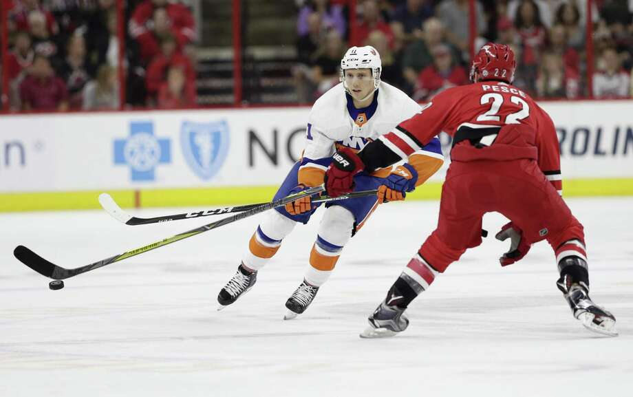 The New York Islanders' Tanner Fritz (11) is defended by the Carolina Hurricanes' Brett Pesce during the first period of a game on Oct. 4 in Raleigh, N.C. Photo: Gerry Broome / Associated Press / Copyright 2018 The Associated Press. All rights reserved