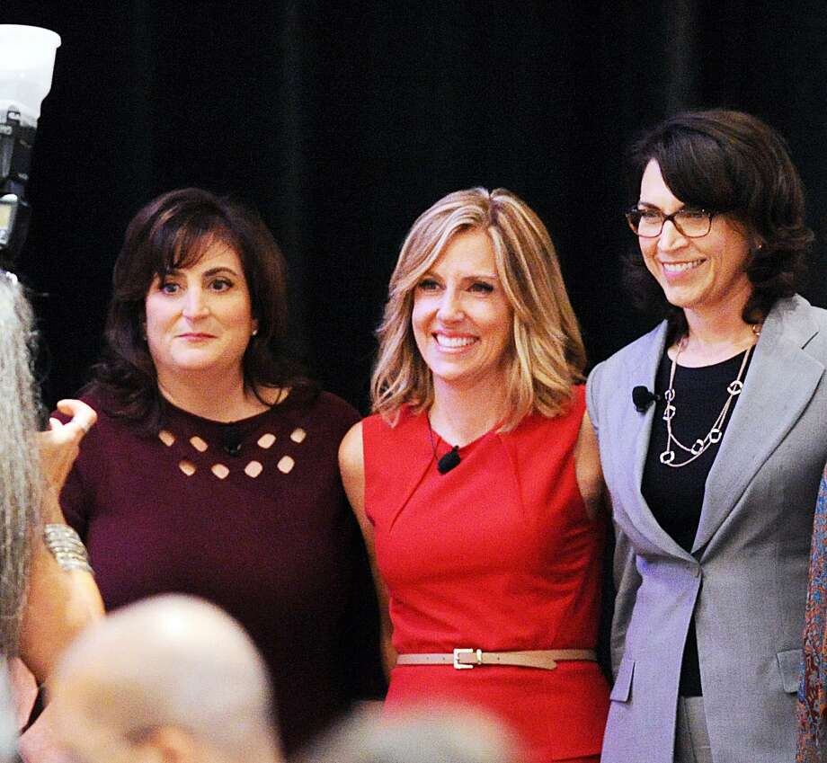 """Women With Impact Award winners Robin Imbrogno, left, and Stacy Janiak, right, pose for a photo with Alisyn Camerota, CNN """"New Day"""" anchor during the Women's Business Development Council's """"Women Rising"""" annual gala luncheon and awards ceremony at Hyatt Regency Greenwich on Friday. Imbrogno is president, CEO and founder of the Human Resource Consulting Group and Janiak is chief client officer for Deloitte. Photo: Bob Luckey Jr. / Hearst Connecticut Media / Greenwich Time"""