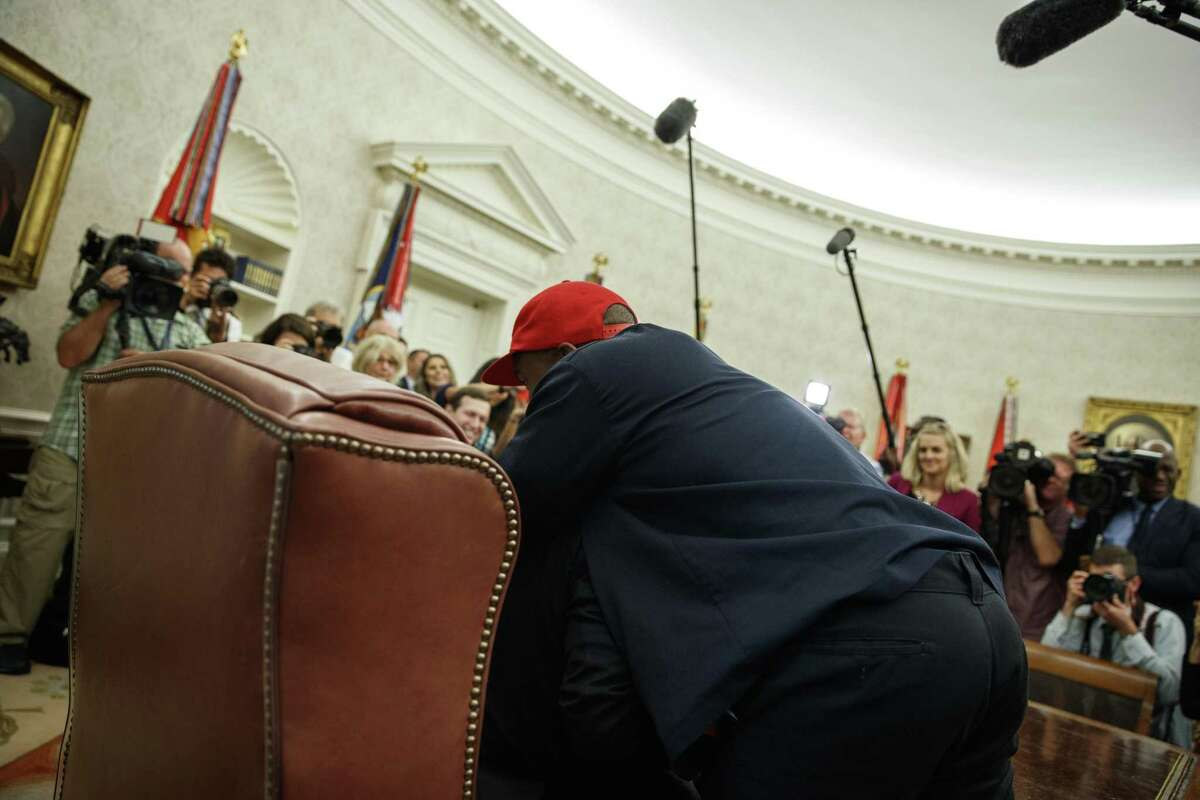 Rapper Kanye West hugs President Donald Trump during a meeting in the Oval Office of the White House Thursday in Washington.