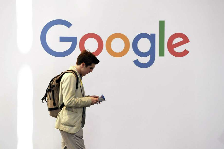 A man walks past the logo of the U.S. multinational technology company Google in May during the VivaTech trade fair ( Viva Technology), in Paris. Such technological behemoths represent a threat to traditional newspapers and news. Photo: ALAIN JOCARD /AFP /Getty Images / AFP or licensors