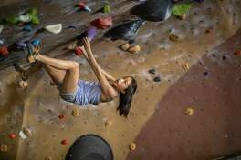 Abbie Cheng, 13, climbs the underside of a climbing wall at Planet Granite on Thursday, Sept. 27, 2018, in San Francisco, CA. She competed in the next American Ninja Warrior Junior.
