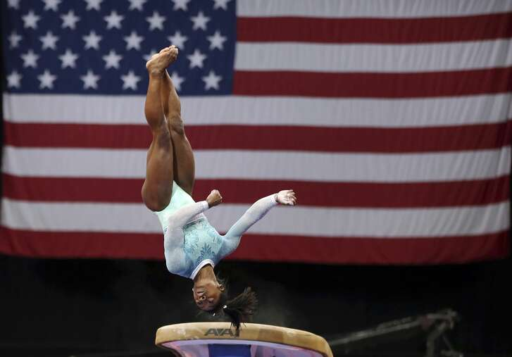 Simone Biles competes on the vault at the U.S. Gymnastics Championships, Sunday, Aug. 19, 2018, in Boston. (AP Photo/Elise Amendola)