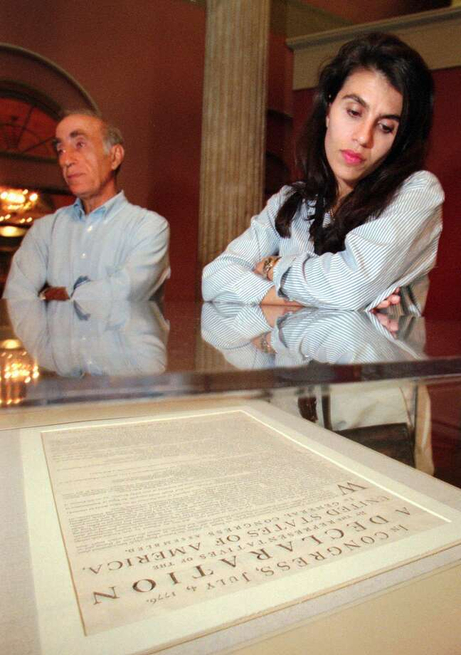 In 1997, visitors study a a copy of the Declaration of Independence in Philadelphia. In 2018, a survey revealed that only a third of those asked could name the three branches of government. Photo: Associated Press File Photo / AP