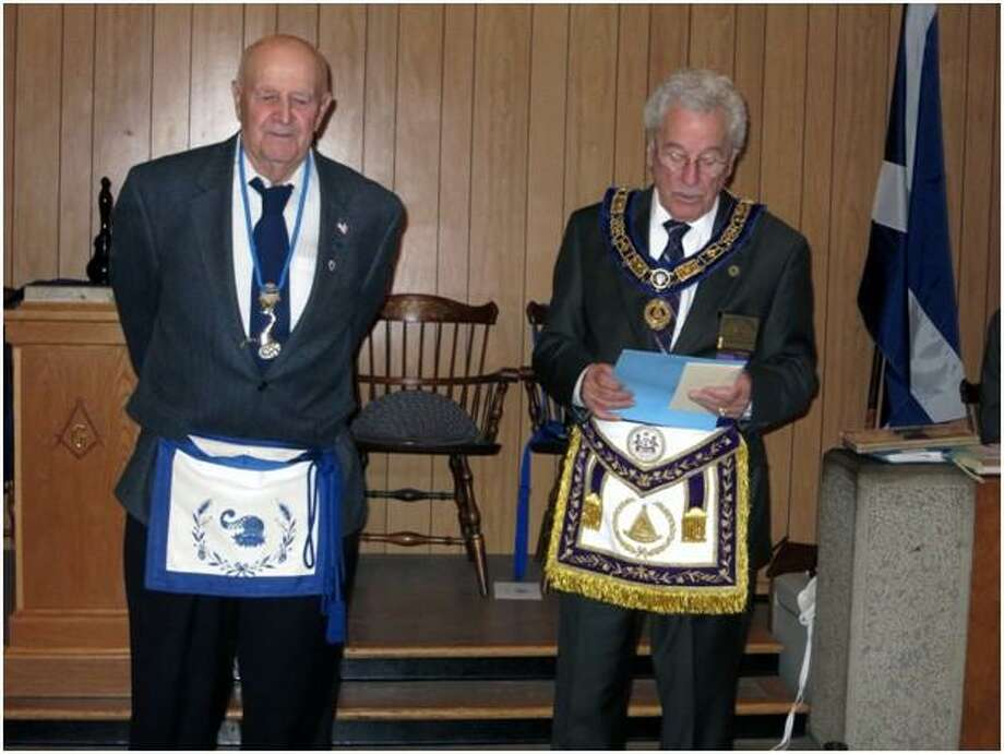 """Maurice R. """"Moe"""" Gabelmann, left, was awarded the Masonic Pier Pont Edwards award, the highest Masonic honor in Connecticut, at St. Andrews #64 Lodge, Winsted, on Wednesday, Oct. 3. The award was presented by the Grand Master of Connecticut, Marshall Robinson. Photo: Contributed Photo /"""