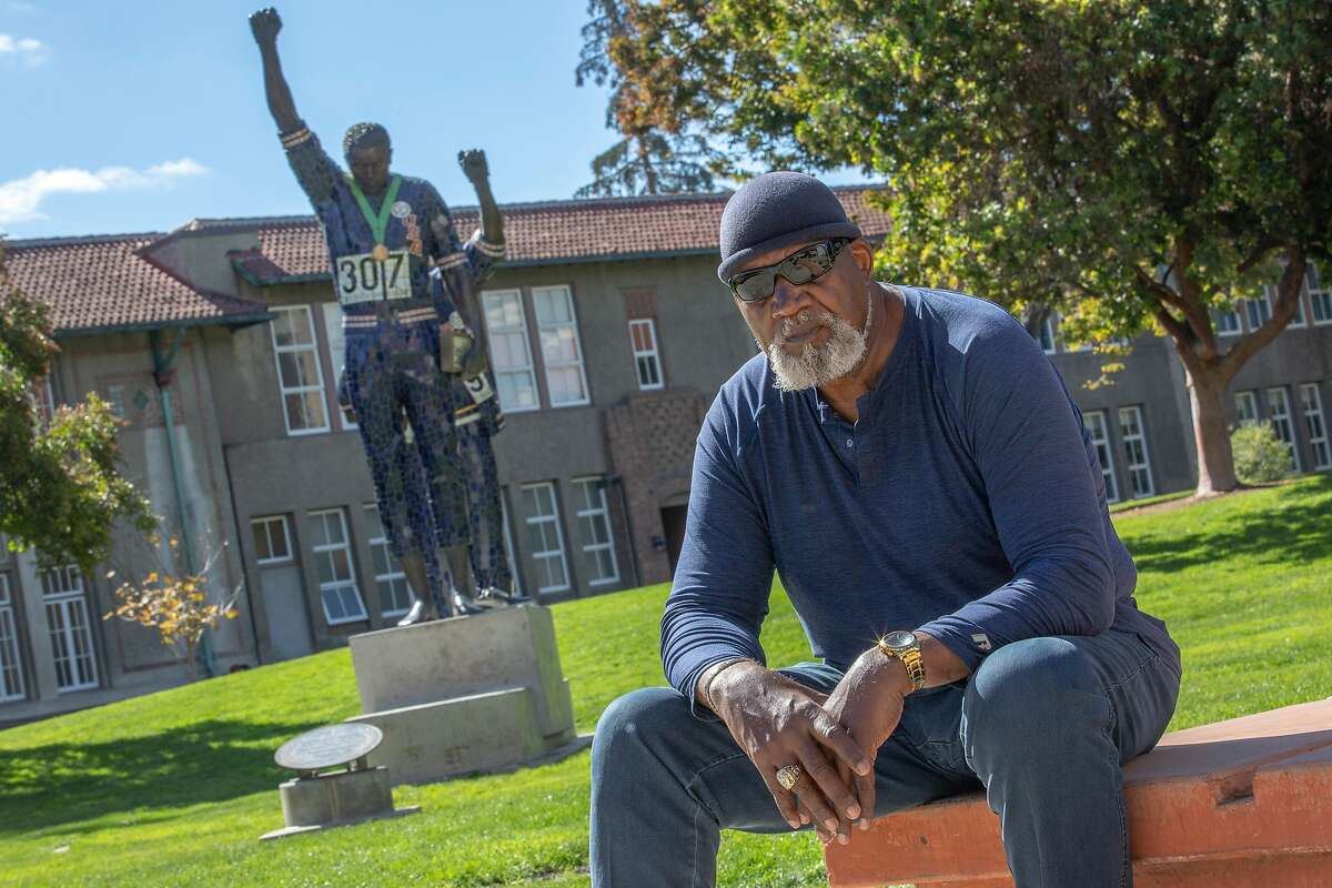 Harry Edwards sits for a portrait with the Olympic Black Power Statue at San Jose State University on Wednesday, Oct. 10, 2018, in San Jose, Calif.