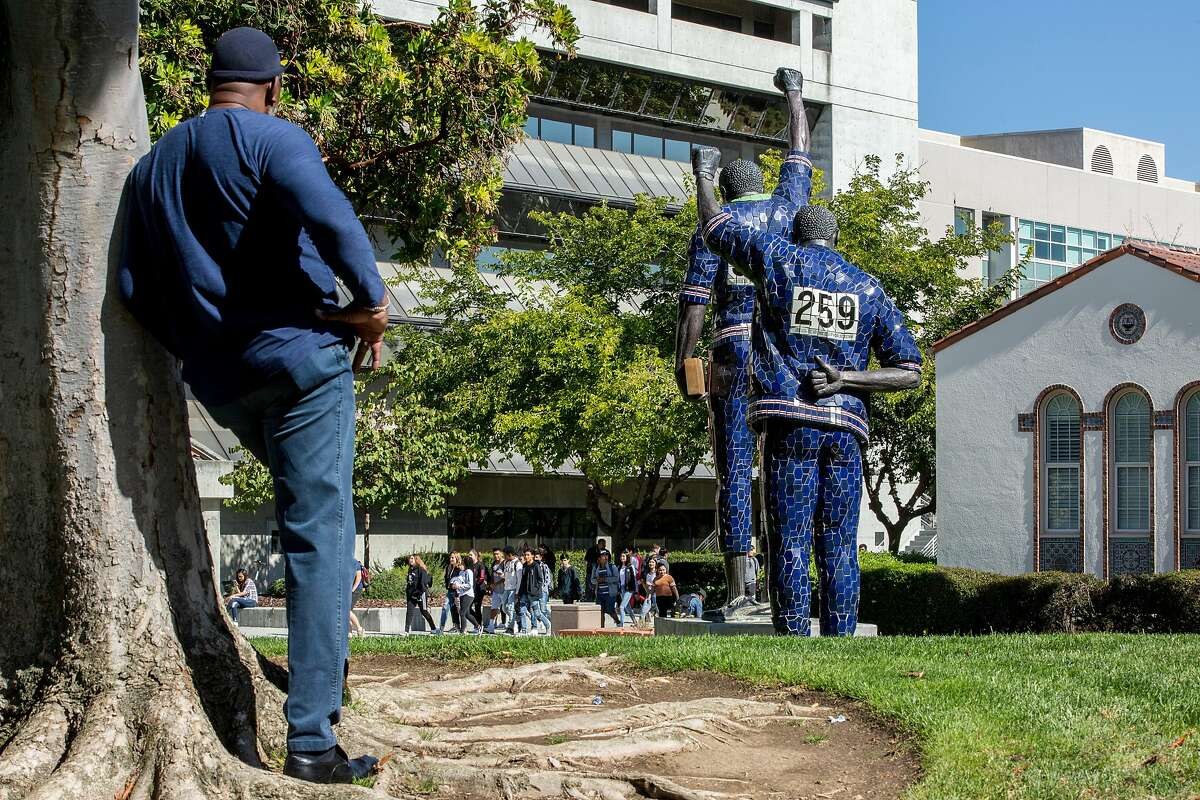 Harry Edwards stands for a portrait with the Olympic Black Power Statue at San Jose State University on Wednesday, Oct. 10, 2018, in San Jose, Calif.