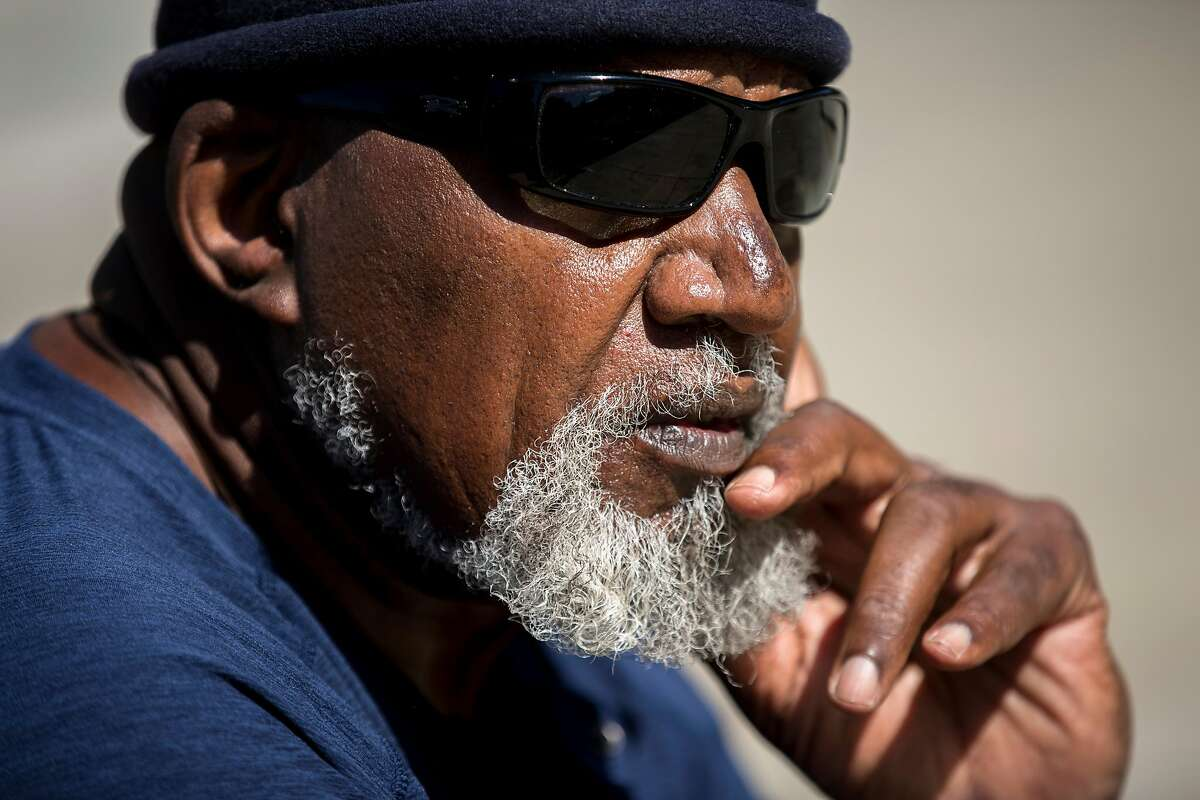 Harry Edwards sits for a portrait at the site of the Olympic Black Power Statue at San Jose State University on Wednesday, Oct. 10, 2018, in San Jose, Calif.