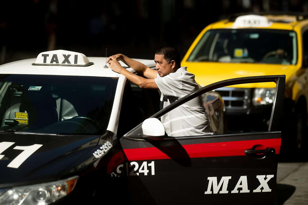 Taxi driver Rhad Salinas waits for a fare outside the Marriott Marquis on Friday, Oct. 12, 2018, in San Francisco.