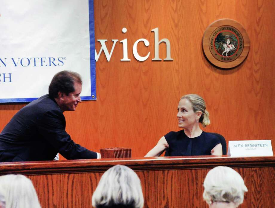 The conclusion of the League of Women Voters of Greenwich State Senate debate is seen here as incumbent Republican L. Scott Frantz, left, for the 36th State Senate District, shakes hands with his Democratic challenger Alexandra Bergstein at Greenwich Town Hall on Wednesday. Photo: Bob Luckey Jr. / Hearst Connecticut Media / Greenwich Time