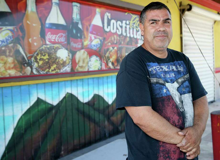 Mexican immigrant Sandro Alejandro Garcia Moreno stands by the grill area of what used to be Pollos Medina near Mission, Texas, Sunday, August 19, 2018. Garcia was a victim of wage theft when he worked at Pollos Medina starting in 2013. He and co-worker Jose Manuel Arciga Garcia sued and won a $108,000 settlement through the Fair Labor Standards Act in 2016. Photo: JERRY LARA, San Antonio Express-News / © 2018 San Antonio Express-News
