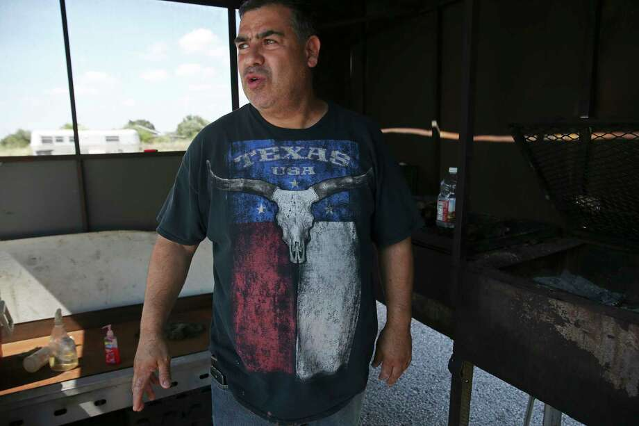 Sandro Alejandro Garcia Moreno talks about grilling chickens at a restaurant where he worked and lived in San Carlos, Texas, Sunday, August 19, 2018. Photo: JERRY LARA, San Antonio Express-News / © 2018 San Antonio Express-News