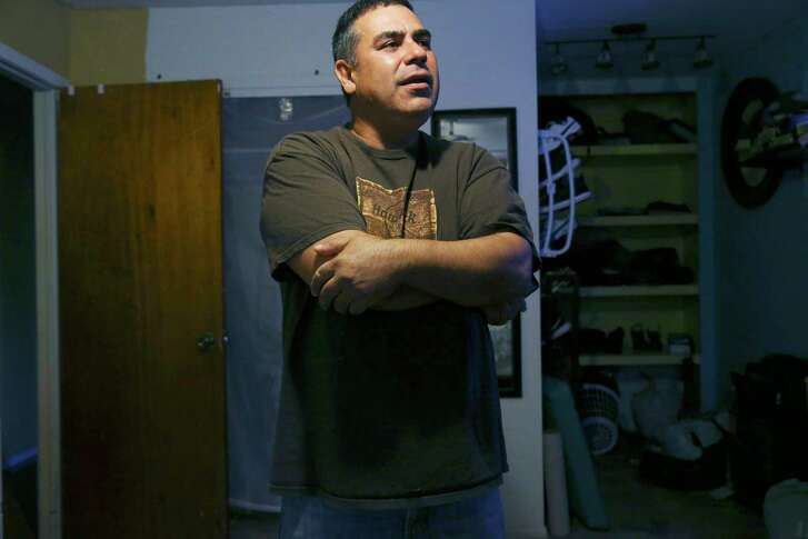 Sandro Alejandro Garcia Moreno looks around his room in the Rio Grande Valley, Thursday, Sept. 27, 2018. He recently moved into the room at a house with two other Mexican immigrants. He works day jobs to pay rent and support his wife and 11-year-old daughter in Mexico. Before, he was living in a restaurant where he grilled chickens in San Carlos, Texas.