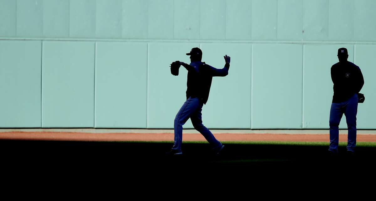 Houston Astros starting pitcher Charlie Morton throws a ball in the outfield as pitching coach Brent Strom looks on as the Astros worked out at Fenway Park, Friday, October 12, 2018, in Boston, in preparation for Game 1 of the ALCS against the Boston Red Sox.