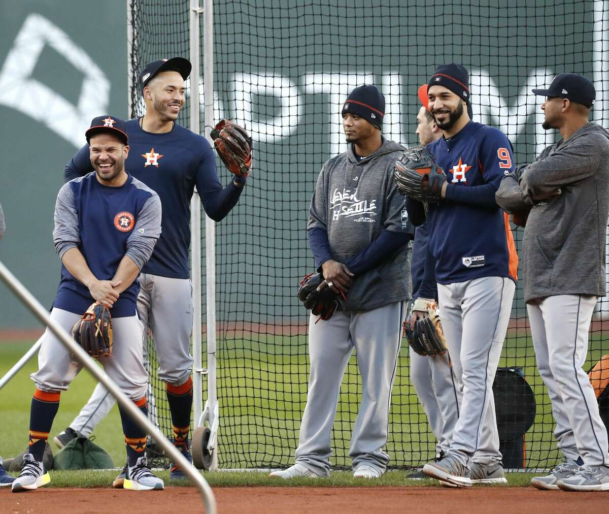 Houston Astros Jose Altuve, Carlos Correa, Martin Maldonado, Marwin Gonzalez, and Yuli Gurriel watch batting practice as the Astros worked out at Fenway Park, Friday, October 12, 2018, in Boston , in preparation for Game 1 of the ALCS against the Boston Red Sox.