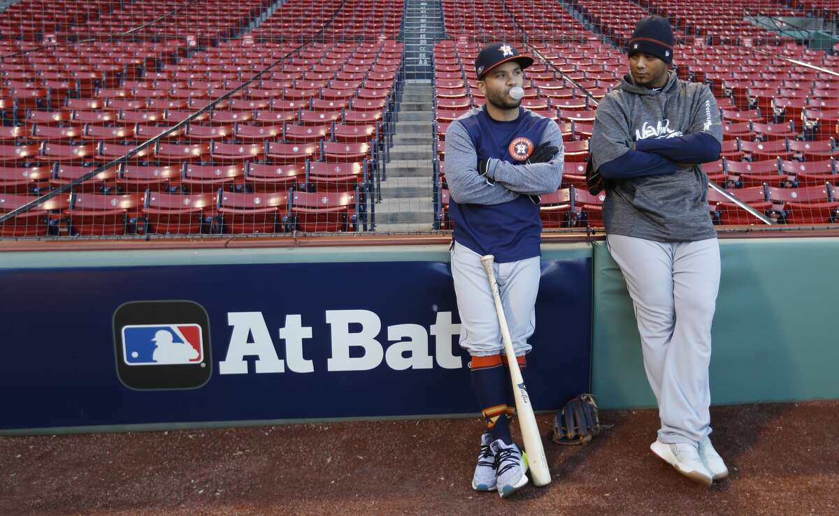 Houston Astros Jose Altuve (27) and Martin Maldonado (15) lean against the wall as they get ready to work out at Fenway Park, Friday, October 12, 2018, in Boston , in preparation for Game 1 of the ALCS against the Boston Red Sox.