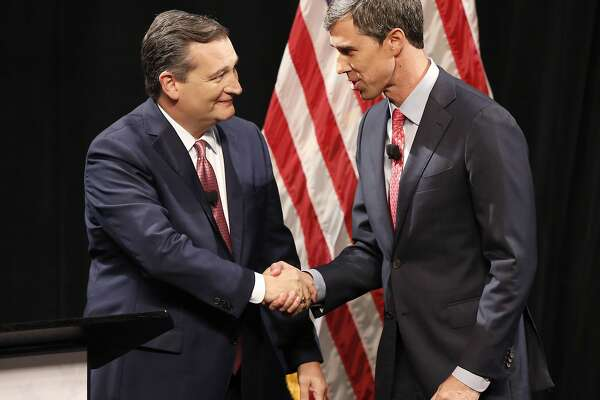 Republican U.S. Senator Ted Cruz, left, and Democratic U.S. Representative Beto O'Rourke, right, shake hands before their first debate for the Texas U.S. Senate in Dallas, Sept. 21, 2018. (Nathan Hunsinger/The Dallas Morning News via AP, Pool)