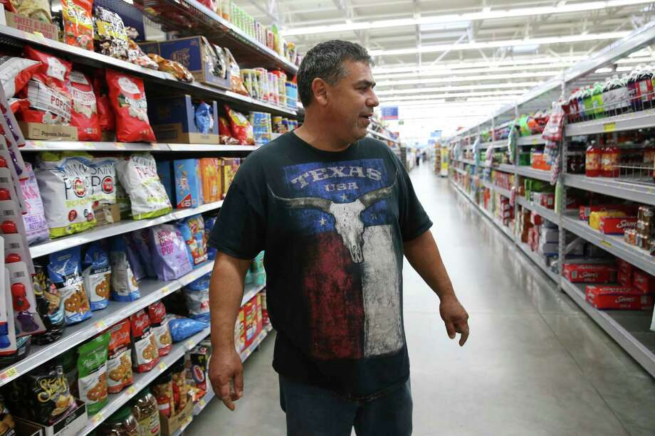 Mexican immigrant Sandro Alejandro Garcia Moreno shops for snack to sent to his 11-year-old daughter in Mexico, Sunday, August 19, 2018. Garcia was a victim of wage theft when he worked at Pollos Medina in Mission, Texas starting in 2013. He and two other employees of the restaurant sued and were able to recoup some of their wages in a settlement in 2016. Photo: JERRY LARA, San Antonio Express-News / © 2018 San Antonio Express-News