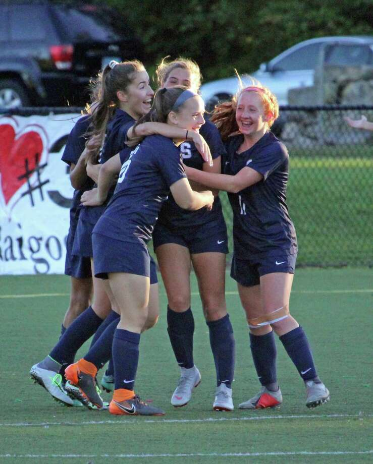 Staples players celebrate a second-half goal during an FCIAC girls soccer match between Darien and Staples on Friday, Oct. 12, 2018 in Westport, Conn. Staples defeated Darien 3-1. Photo: Anthony E. Parelli / Hearst Connecticut Media / Darien News