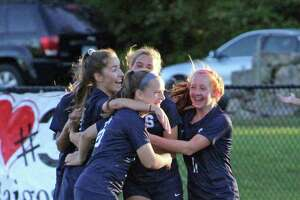 Staples players celebrate a second-half goal during an FCIAC girls soccer match between Darien and Staples on Friday, Oct. 12, 2018 in Westport, Conn. Staples defeated Darien 3-1.