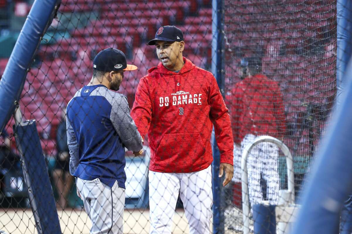 Red Sox manager Alex Cora, greeting Jose Altuve during the 2018 ALCS, said the vitriol his old team faced Tuesday night affected him.
