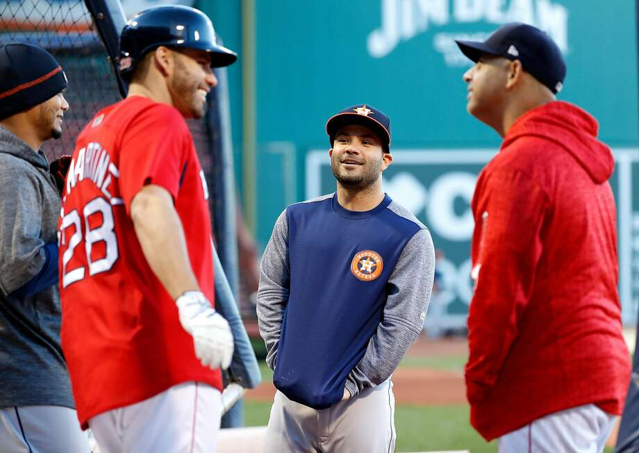 Boston's J.D. Martinez (left) and Houston's Jose Altuve (center) came up together in the Astros' minor-league system. Photo: Karen Warren / Staff Photographer