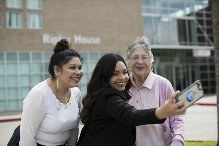 Didi Martinez, 28, Naiyolis Palomo, 24, and Marie Moreno, 77, pose for a selfie outside the Ripley House in Houston, Friday, March 2, 2018 after casting their votes early. ( Marie D. De Jesus / Houston Chronicle )