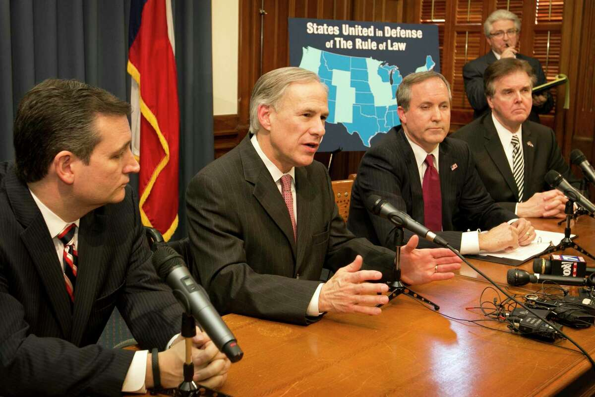 From left to right, Texas Sen. Ted Cruz, Gov. Greg Abbott, and Attorney General Ken Paxton at a news conference at the Capitol in Austin, Texas, Wednesday, Feb. 18, 2015. (Austin American-Statesman, Jay Janner)
