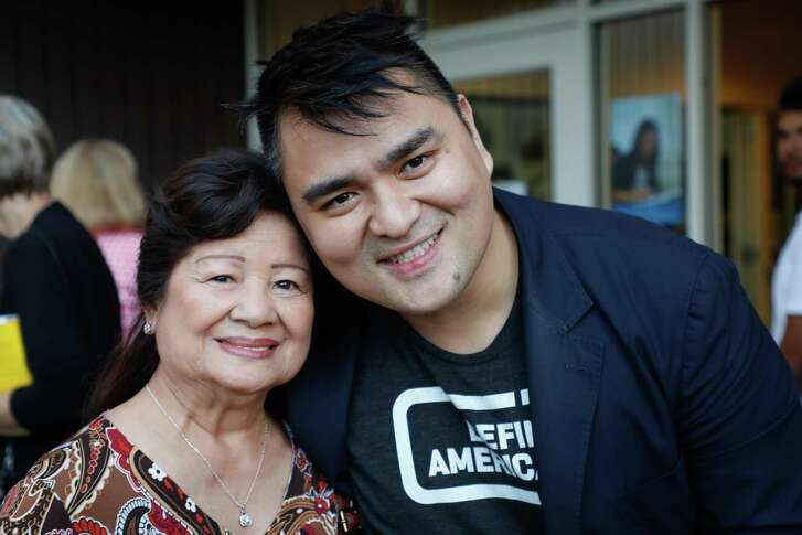 """Pulitzer Prize-winning journalist and founder of Define American Jose Antonio Vargas poses for a portrait with his grandmother, Lola Florie, as he attends a private book-launch event for his new book """"Dear America: Notes of an Undocumented Citizen"""" at Mountain View High School in Mountain View, Calif."""