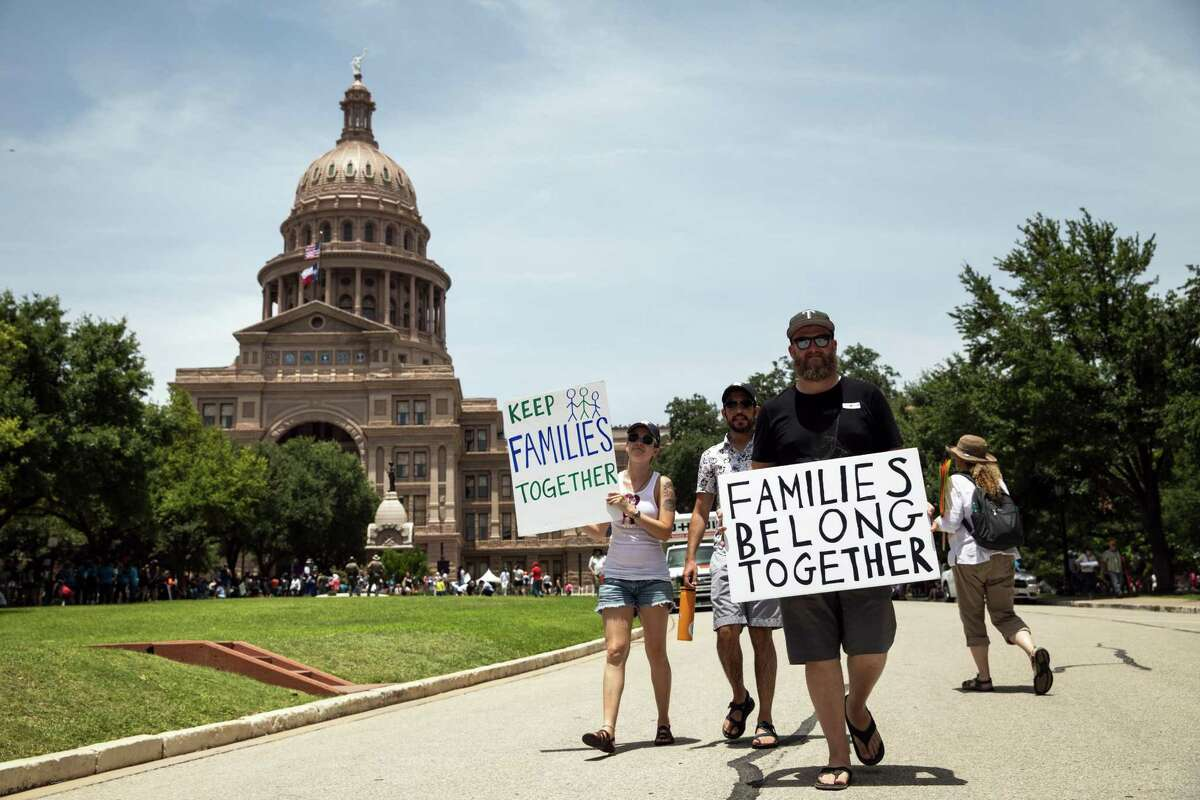 Demonstrators rally against the Trump administration's immigration policies outside of the Texas Capitol in Austin, Texas, on June 30, 2018.