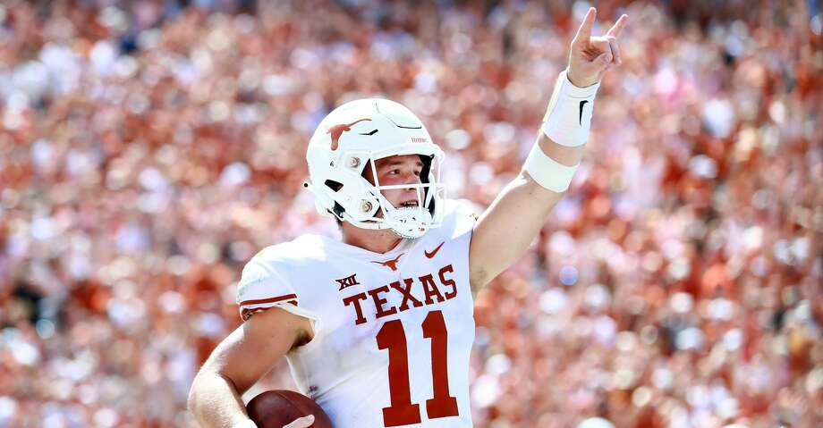 DALLAS, TX - OCTOBER 06:  Sam Ehlinger #11 of the Texas Longhorns celebrates after scoring a touchdown against the Oklahoma Sooners in the third quarter of the 2018 AT&T Red River Showdown at Cotton Bowl on October 6, 2018 in Dallas, Texas.  (Photo by Tom Pennington/Getty Images) Photo: Tom Pennington/Getty Images