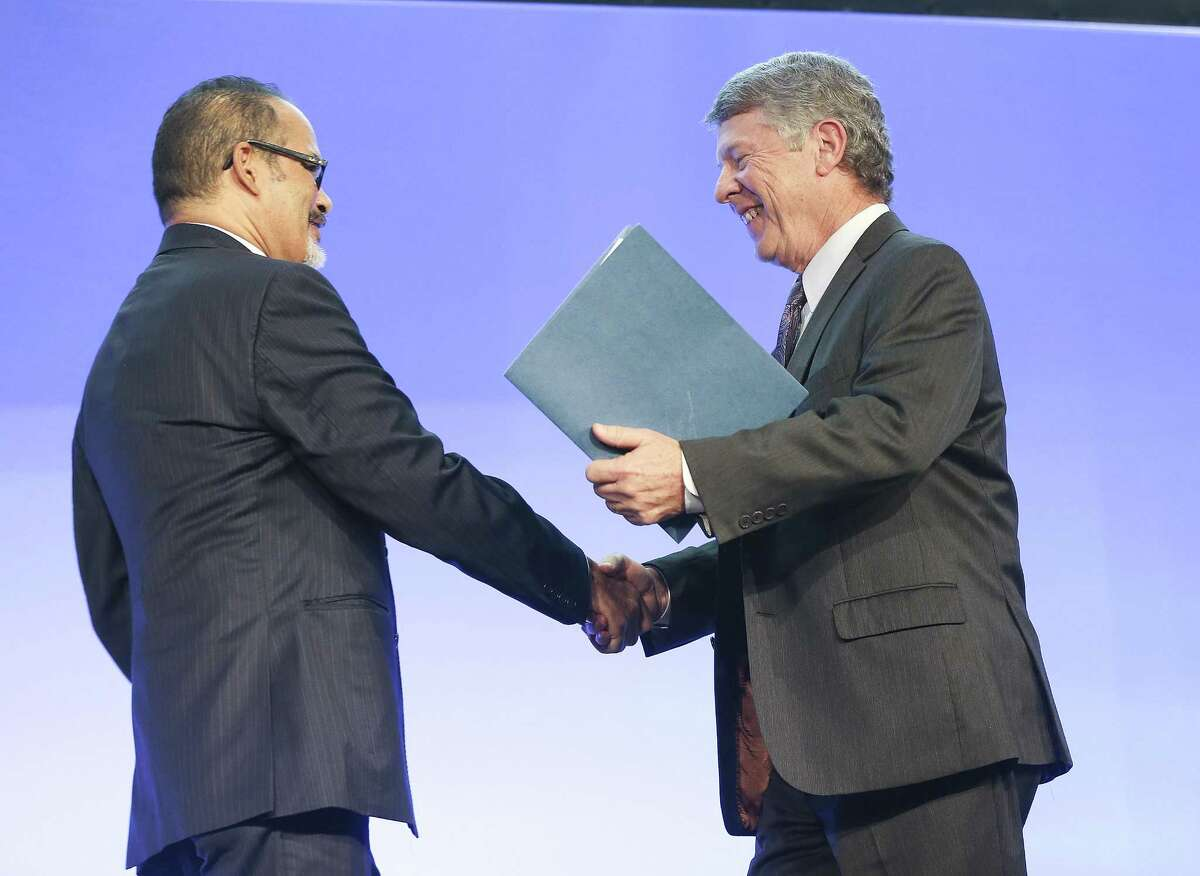 Texas State Rep. Garnet Coleman shakes hands with Harris County Judge Ed Emmett during the Greater Houston Partnership's State of County luncheon on Thursday, September 13, 2018 at NRG Center in Houston.