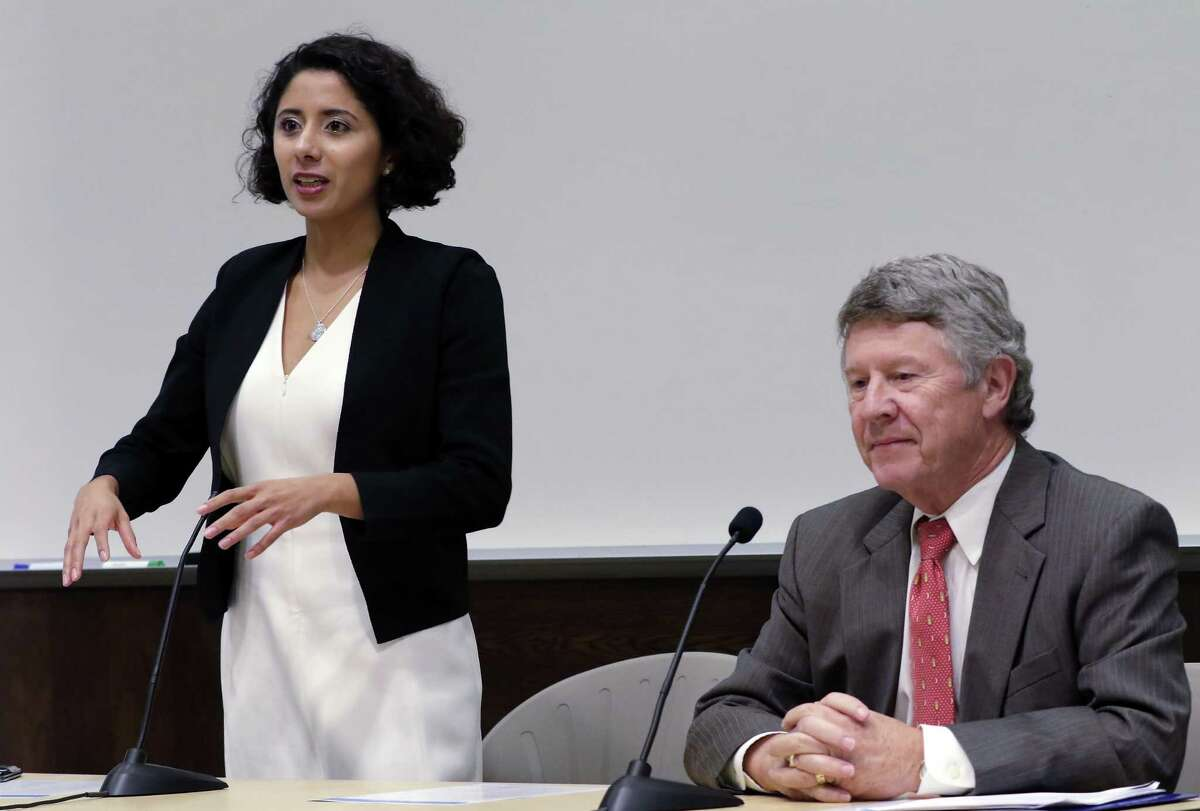 Lina Hidalgo, left, Democratic candidate for Harris County judge, speaks during a debate with republican incumbent Ed Emmett, right, held at the School of Public Affairs at Texas Southern University Thursday, Sep. 27, 2018 in Houston, TX.