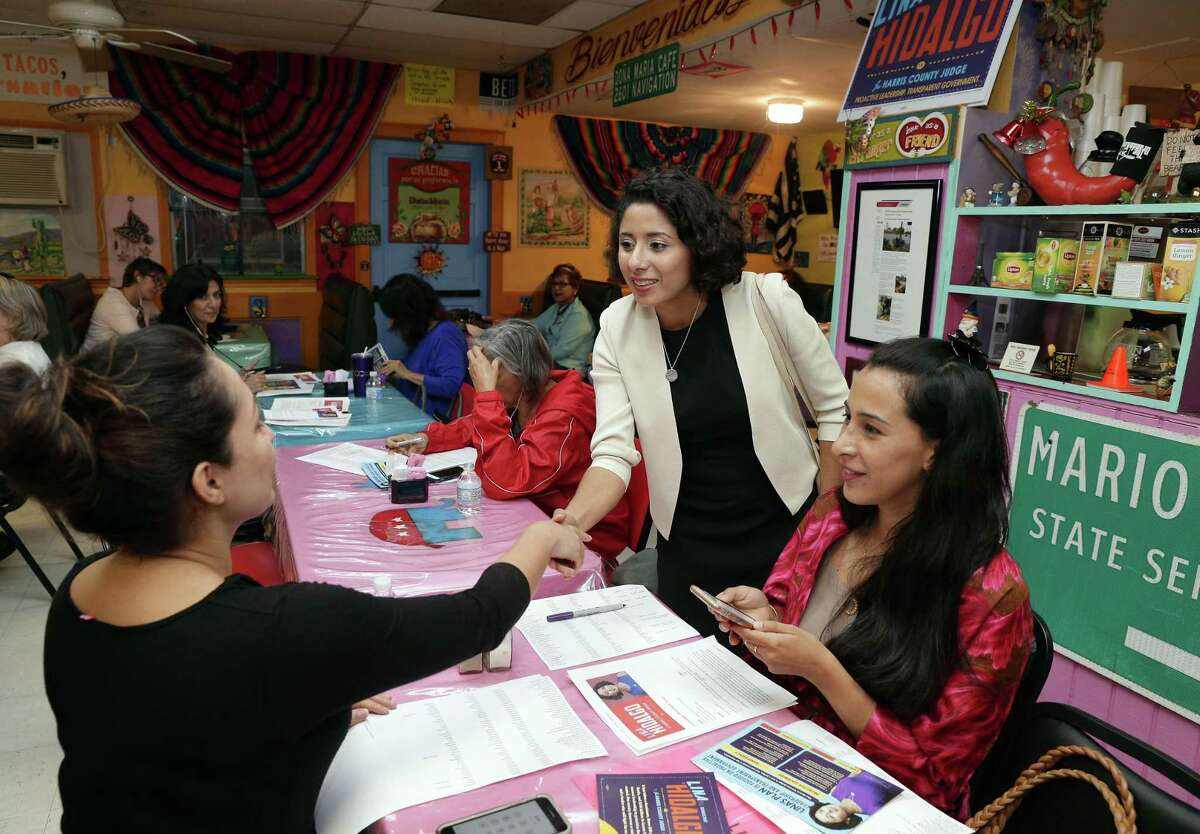 Democratic Harris County judge candidate Lina Hidalgo, center, greets volunteers Catalina Soto, left, and Lilicena Omos, right, as Hidalgo arrives at a campaign phone bank at Dona Maria Mexican Cafe Wednesday, Sep. 26, 2018 in Houston, TX.