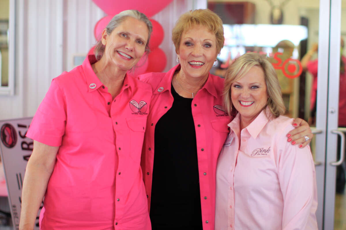 From left, Peggy Floyd of Jake's Clays, Debbie Bergen, and Christi Brown of Pink The Basin during the Saving True Pairs clay shoot fundraiser for Pink The Basin Oct. 12, 2018, at Jake's Clays. James Durbin/Reporter-Telegram